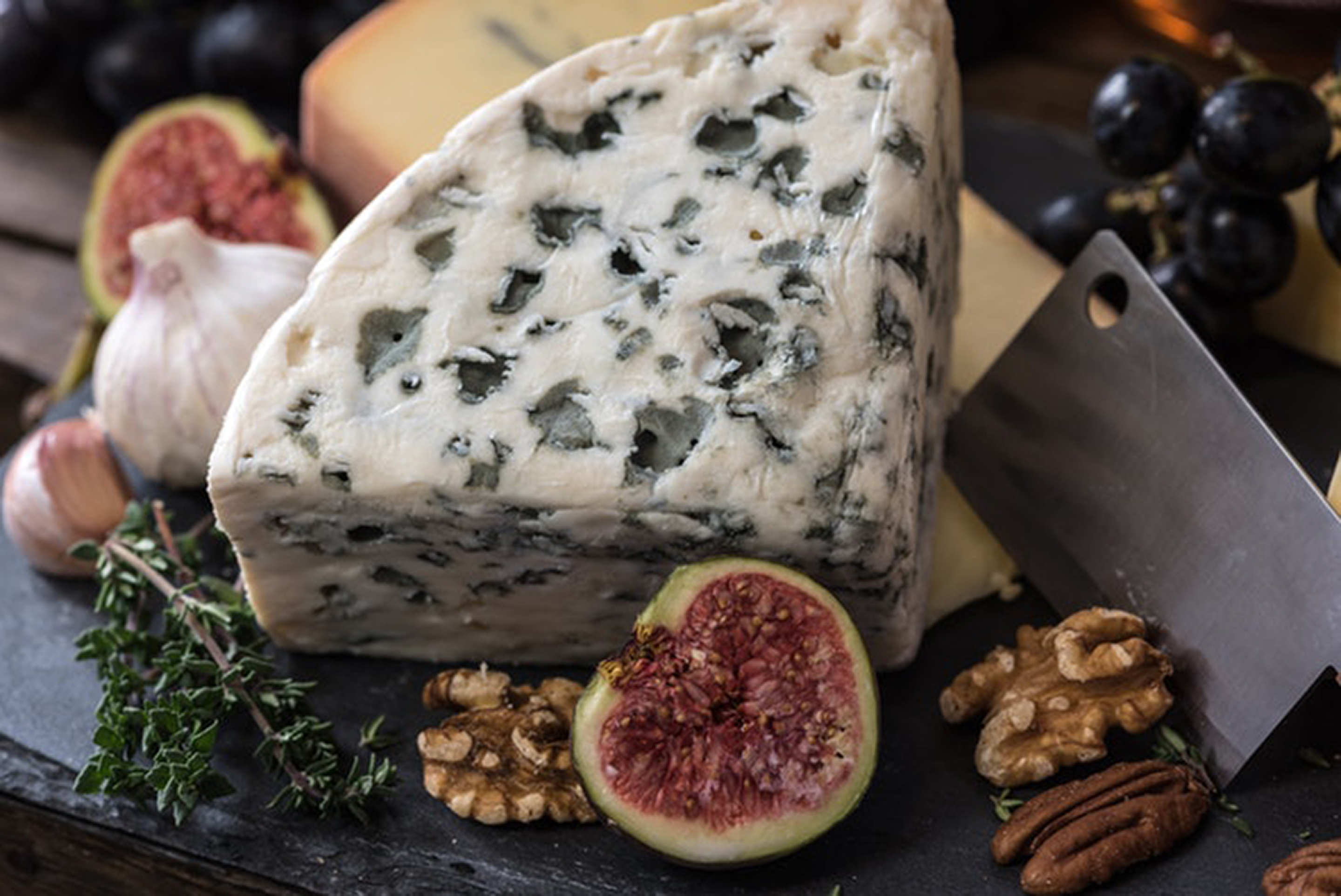 Close up of blue cheese, nuts and a fresh fig