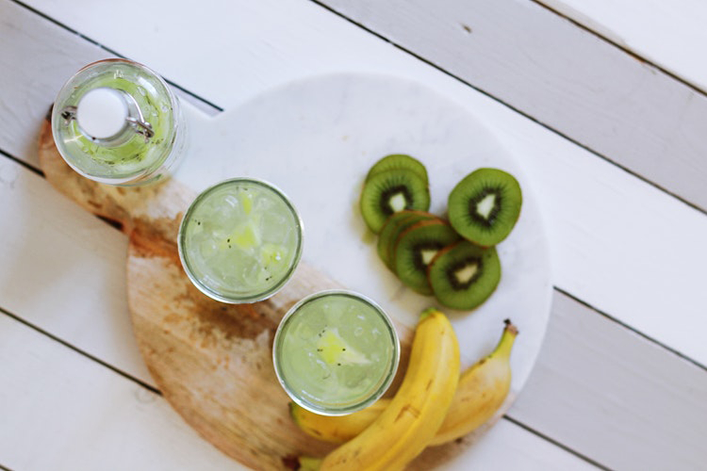 Kiwi, bananas and smoothies on a table
