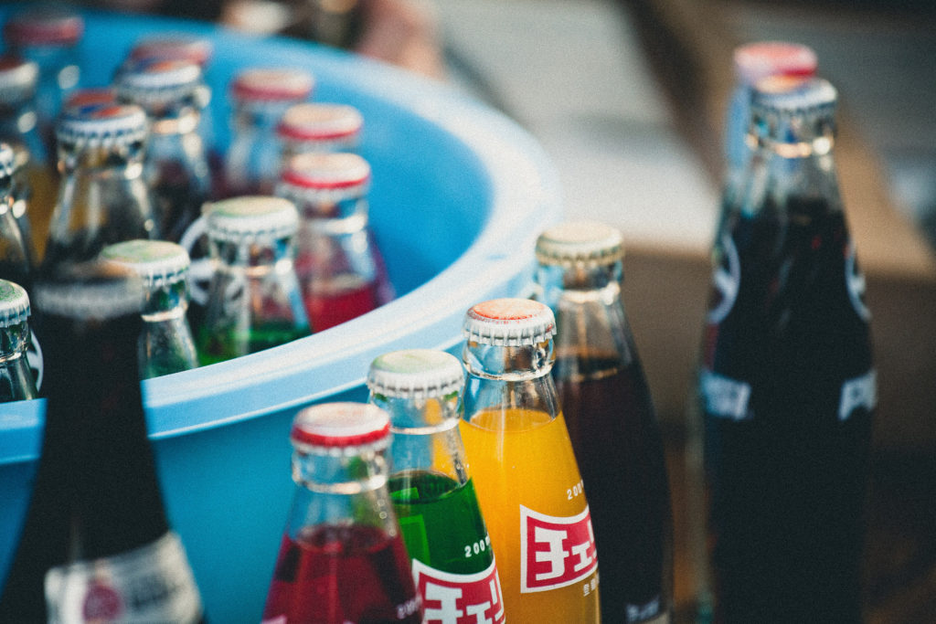 close-up of assorted soda bottles