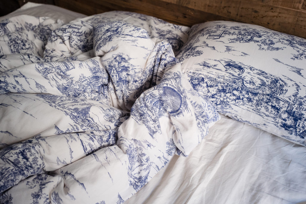 Close-up of sheets on bed